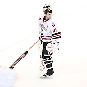 Clay Witt #31 of the Northeastern Huskies on the ice during the game at Matthews Arena on February 22, 2014 in Boston, Massachusetts. (Photo by Elan Kawesch)