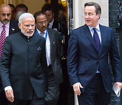 Downing Street, London, November 12th 2015. British Prime Minister David Cameron leaves Downing Street with his Indian counterpart Narendra Modi, on their way to a press conference at the Foreign Office.