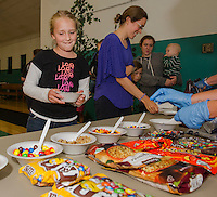 """Elizabeth Runyan's shirt says it all """"love, love, love...."""" as she decides which toppings for her ice cream sundae at the Laconia Summer Program's final day at the Community Center on Wednesday afternoon.  (Karen Bobotas/for the Laconia Daily Sun)"""