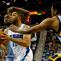 April 15, 2012; New Orleans, LA, USA; New Orleans Hornets shooting guard Eric Gordon (10) drives past Memphis Grizzlies small forward Rudy Gay (22) and shooting guard Tony Allen (9) during the first quarter of a game at the New Orleans Arena.   Mandatory Credit: Derick E. Hingle-US PRESSWIRE