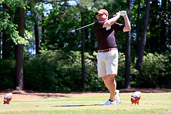 David Dukes tees off during the Chick-fil-A Peach Bowl Challenge at the Oconee Golf Course at Reynolds Plantation, Sunday, May 1, 2018, in Greensboro, Georgia. (Paul Abell via Abell Images for Chick-fil-A Peach Bowl Challenge)