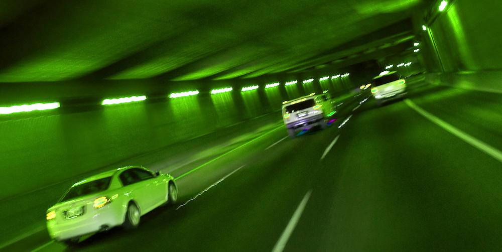 cars speeding through tunnel