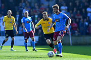 Scunthorpe United defender Scott Wiseman (2) and Bolton Wanderers striker Adam Le Fondre (45)  during the EFL Sky Bet League 1 match between Scunthorpe United and Bolton Wanderers at Glanford Park, Scunthorpe, England on 8 April 2017. Photo by Ian Lyall.