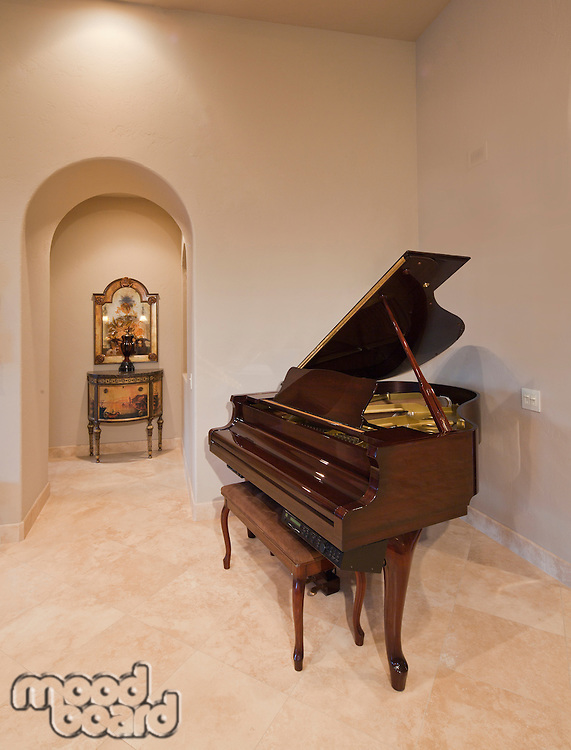 Baby grand piano in corner of luxury home