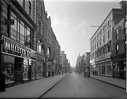 30/11/1952<br /> 11/30/1952<br /> 30 November 1952<br /> Dublin street scene. View down Henry Street towards Mary Street near the  Junction of Liffey Street Upper and the now disappeared Denmark Street Little. Image for Maurice L. Clifford Solicitors for accident case.