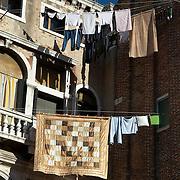 Italy, Veneto, Venice. November/12/2007...Laundry hung out to dry under a morning sun, in Venice, Italy..