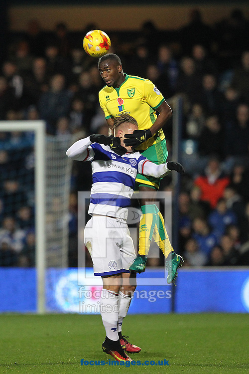 Sebastien Bassong of Norwich gets to grips with Sebastian Polter of Queens Park Rangers as he wins a header during the Sky Bet Championship match at the Loftus Road Stadium, London<br /> Picture by Paul Chesterton/Focus Images Ltd +44 7904 640267<br /> 19/11/2016