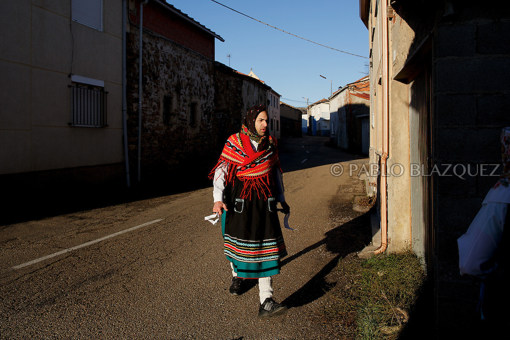 A man dressed as La Madama (madame) walks the streets during La Filandorra festival on December 26, 2016 in the small village Ferreras de Arriba, Zamora province, Spain.  La Filandorra festival is a pagan winter masquerade that takes place during Saint Esteban festivities. The parade is represented by four characters, La Filandorra, El Diablo (Devil), La Madama (madame) y El Galán (Gallant). (© Pablo Blazquez)