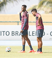 Danny Welbeck of England (L) with Daniel Sturridge of England (R) who feels his right thigh during the England open training session at Est&aacute;dio Claudio Coutinho, Urca, Rio de Janeiro<br /> Picture by Andrew Tobin/Focus Images Ltd +44 7710 761829<br /> 16/06/2014