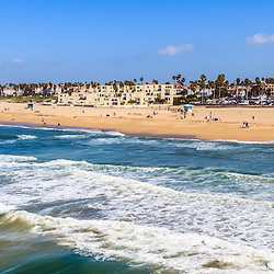 Huntington Beach California panorama photo of the Southern California beach coastline. Panoramic photo ratio is 1:3. Huntington Beach is also known as Surf City USA and is a seaside beach city along the Pacific Ocean in Orange County.