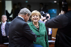 Angela Merkel, Germany's chancellor, center, speaks to a colleague during the EU Summit, at the European Council headquarters in Brussels, Belgium on Friday, Oct. 19, 2012. (Photo © Jock Fistick)
