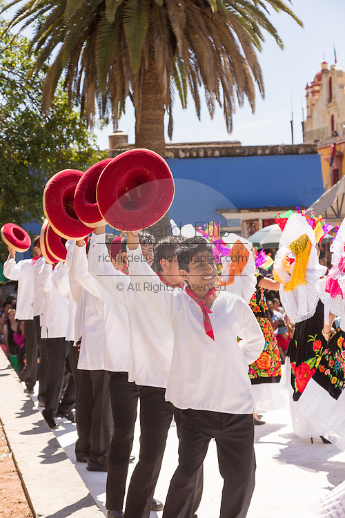 Traditional costumed male Istmo folk dancers perform outside the Santo Domingo church during the Day of the Dead Festival known in spanish as Día de Muertos on October 26, 2014 in Oaxaca, Mexico.