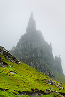 Rock pinnacle in fog on the Trotternish Peninsula, Isle of Skye Scotland