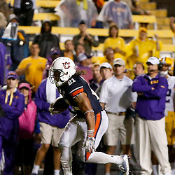 Sep 21, 2013; Baton Rouge, LA, USA; Auburn Tigers running back Tre Mason (21) against the LSU Tigers during the second half of a game at Tiger Stadium. LSU defeated Auburn 35-21. Mandatory Credit: Derick E. Hingle-USA TODAY Sports