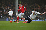 Fulham defender, Dan Burn (33) yellow card for this late challange during the Sky Bet Championship match between Fulham and Charlton Athletic at Craven Cottage, London, England on 20 February 2016. Photo by Matthew Redman.