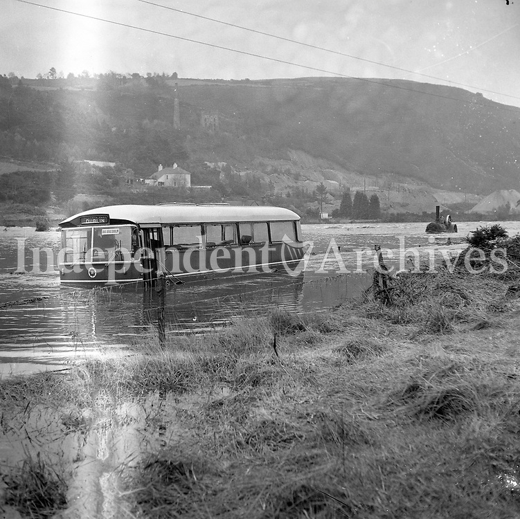A bus caught in the floods near Avoca, Co.Wicklow 18 November 1965.<br /> (Part of the Independent Newspapers Ireland/NLI Collection)