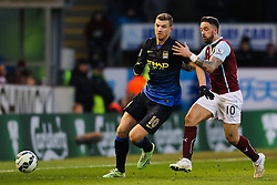 Manchester City's Edin Dzeko is chased by Burnley's Danny Ings   - Photo mandatory by-line: Matt McNulty/JMP - Mobile: 07966 386802 - 14/03/2015 - SPORT - Football - Burnley - Turf Moor - Burnley v Manchester City - Barclays Premier League