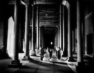 Kashmiri family wends its way through the columns of Jama Masjid (Mosque), Srinigar, Kashmir.