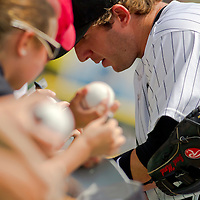 Chicago, IL - June 05, 2011:  Brent Morel (22) signs autographs for the fans before the Chicago White Sox play host to the 2nd place visiting Detroit Tigers at U.S. Cellular Field on June 05, 2011 in Chicago, IL.