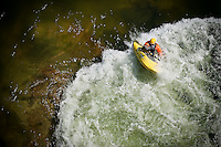 JEROME A. POLLOS/Press..The massive boulder below the surface of the Spokane River is what causes the water to churn offering a prime spot for freestyle kayakers such as Jud Keiser shown here rotating his small craft through the turbulent water.
