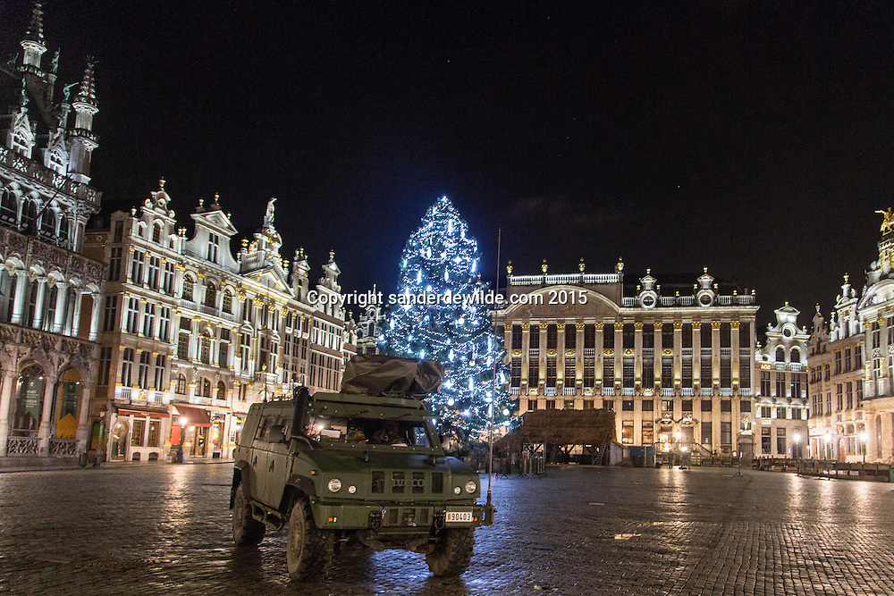22 november 2015 Belgium Brussels. The Big square (Grote Markt) in Brussels, a main tourist attraction with many buildings with medieval facades, is being protected by soldiers in a special military armoured vehicle parked on the square at night.