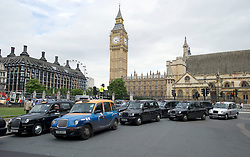 London Taxis protesting at Olympic Lane access - Parliament Square, London 17/07/12London Taxis protesting at Olympic Lane access,Parliament Square, London, Tuesday July 17, 2012. Photo By i-Images
