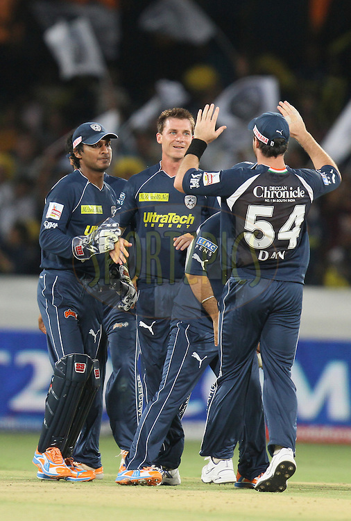Dale Steyn(C) of Deccan Chargers being congratulated by his team mates  during match 11 of the Indian Premier League ( IPL ) between the Deccan Chargers and the Royal Challengers Bangalore held at the Rajiv Gandhi International Cricket Stadium in Hyderabad on the 14th April 2011...Photo by Parth Sanyal/BCCI/SPORTZPICS