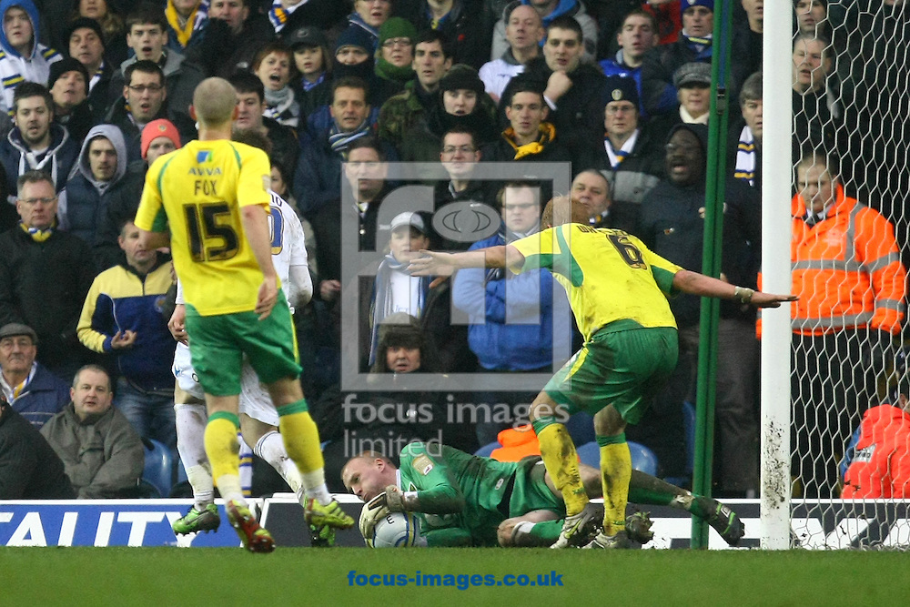 Leeds - Saturday February 19th, 2011: John Ruddy of Norwich saves at the feet of Luciano Becchio of Leeds during the Npower Championship match at Elland Road, Leeds. (Pic by Paul Chesterton/Focus Images)