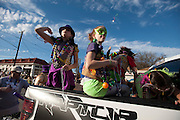 Parade participants throw beads to fans on Davis Street at the fifth-annual Oak Cliff Mardi Gras Parade on Sunday, February 10, 2013 in Dallas, Texas. (Cooper Neill/The Dallas Morning News)