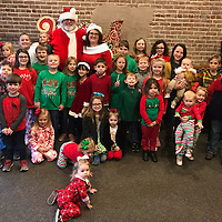 Children pose for a photo at a Breakfast with Santa fundraiser to benefit Nettleton's Dorothy J. Lowe Library. Jimmy and Kimberley Carter filled in with Mr. and Mrs. Claus.
