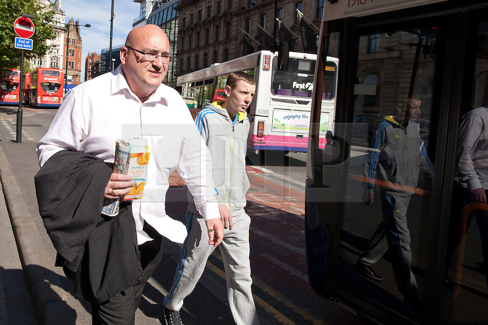 © Licensed to London News Pictures .  08/09/2012 . Manchester, UK . Domenyk Noonan , recently released from prison , walks along Manchester 's Portland Street , accompanied by his Nephew , Kieran Noonan . The area was the scene of looting and rioting on 9th August 2011 , during which Noonan was arrested . Noonan has announced he plans to sue the police over the  arrest . Under the terms of a previous early release , the arrest lead to him being recalled to prison . Photo credit : Joel Goodman/LNP
