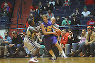 "Louisiana State's Matt Derenbecker (21) is defended by Ole Miss guard Nick Williams (20) at the C.M. ""Tad"" Smith Coliseum in Oxford, Miss. on Wednesday, February 9, 2011. Ole Miss won 66-60 and is now 4-5 in the Southeastern Conference."