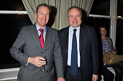 Left to right, FRANK GARDNER and CLIVE ANDERSON at a dinner in aid of the charity Save The Rhino held at ZSL London Zoo, Regents Park, London NW1 on 16th November 2011.