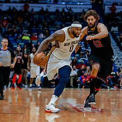 Jan 22, 2018; New Orleans, LA, USA; New Orleans Pelicans center DeMarcus Cousins (0) drives past Chicago Bulls center Robin Lopez (42) during the fourth quarter at the Smoothie King Center. The Pelicans defeated the Bulls 132-128 in double overtime. Mandatory Credit: Derick E. Hingle-USA TODAY Sports