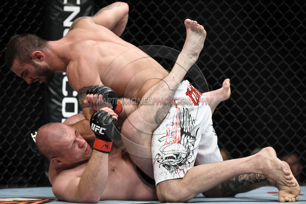 """LONDON, ENGLAND, OCTOBER 2010: Vinicius Queiroz (top) pressures a grounded Rob Broughton during """"UFC 120: Bisping vs. Akiyama"""" inside the O2 Arena in Greenwich, London"""