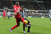 Newcastle United's Defender Paul Dummett holds the ball from Liverpool's Striker Divock Origi during the Barclays Premier League match between Newcastle United and Liverpool at St. James's Park, Newcastle, England on 6 December 2015. Photo by George Ledger.