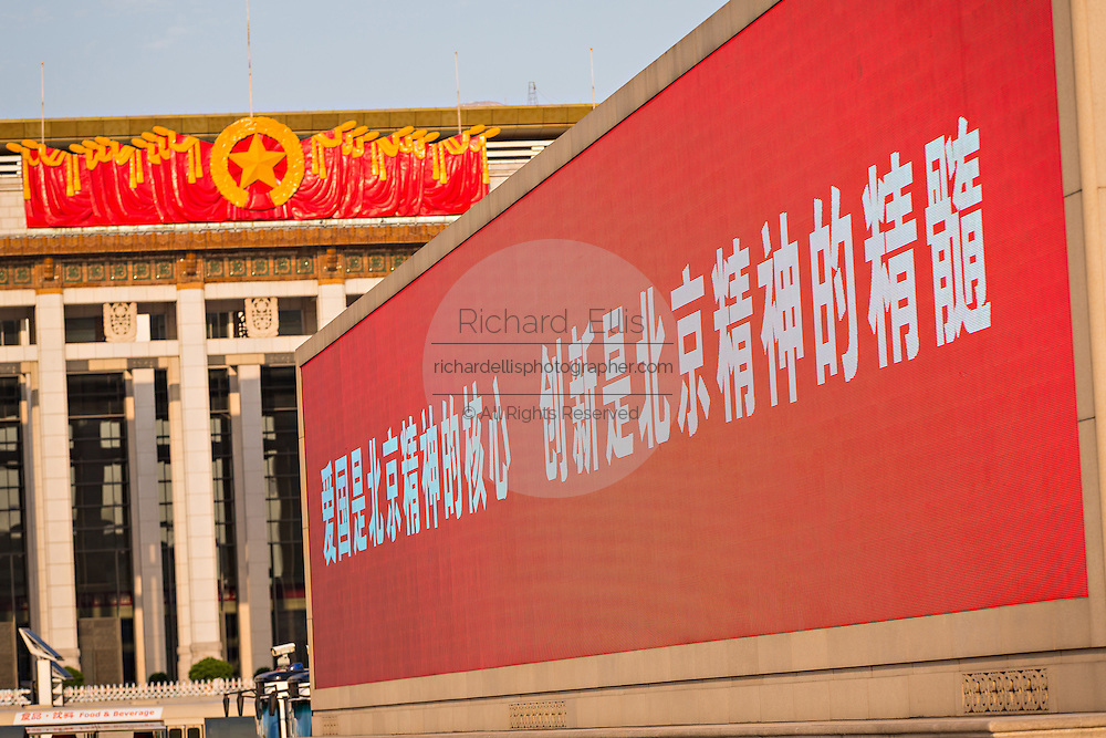 A electronic sign flashes slogans in Tian'an Men square in Beijing, China with the China National Museum in the background.