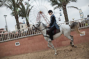 A girl is seen during a horse back riding lesson at the al Fares club.