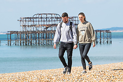 © Licensed to London News Pictures.01/04/2020. Brighton, UK. Members of the public take a break from self isolating to exercise on the beach in Brighton and hove as the Coronavirus lock down continues in its second week. Photo credit: Hugo Michiels/LNP