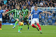 Jake Reeves of AFC Wimbledon and Caolan Lavery battle during the Sky Bet League 2 match between Portsmouth and AFC Wimbledon at Fratton Park, Portsmouth, England on 15 November 2015. Photo by Stuart Butcher.