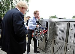 © licensed to London News Pictures. LONDON, UK.  02/06/11. Boris Johnson is shown the bicycle hire scheme at Brompton Bicycles in West London. The Mayor of London Boris Johnson visits two major manufacturing firms today, 02 June 2011, to see the role they play in supporting London's economy and why the UK's capital city  is so critical to their continued success. He called in to Fuller's in Chiswick, London's only traditional family brewery, to see their new multi-million pound brewing facility. He went on to visit Brompton bike factory. Where he met Brompton inventor Andrew Ritchie, who still owns the famous company and remains its Technical Director.  Photo credit should read Stephen Simpson/LNP