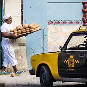 03/10/2017  OLD HAVANA, CUBA    A baker drops a roll from a tray outside a bakery in Havana, Cuba.  (Aram Boghosian for The New Orleans Advocate)