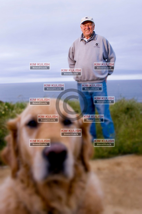 "Portrait of former Calpine CEO Peter Cartwright near his home with his son's dog ""Crockett"" along the Pacific Ocean in La Selva Beach, Calif.."