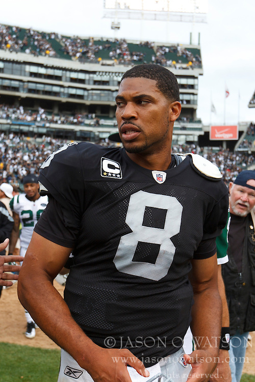 Sep 25, 2011; Oakland, CA, USA;  Oakland Raiders quarterback Jason Campbell (8) leaves the field after the game against the New York Jets at O.co Coliseum. Oakland defeated New York 34-24.