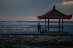 July 26, 2018 - Bali, Indonesia - The sun rises with high waves on July 26, 2018 at Karang beach, Bali, Indonesia. The Meteorology, Climatology and Geophysics Agency is calling for Warning for Sea Wave Increase, High Waves in Indonesian Southern Waters triggered by high wind speeds around Mascarene High of the Indian Ocean (Western Australia) region. (Credit Image: © Muhammad Fauzy/NurPhoto via ZUMA Press)