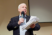 Aug, 25, 2009 -- SUN CITY, AZ: SEN JOHN MCCAIN holds a copy of the health care reform bill during the Town Hall meeting on health care sponsored by Sen McCain at Grace Bible Church in Sun City, AZ, Tuesday. More than 1,000 people attended the meeting in the church, which seats 700. Sun City is a staunchly Republican suburb of Phoenix and most of the crowd was opposed to President Obama health care reform efforts.     Photo by Jack Kurtz