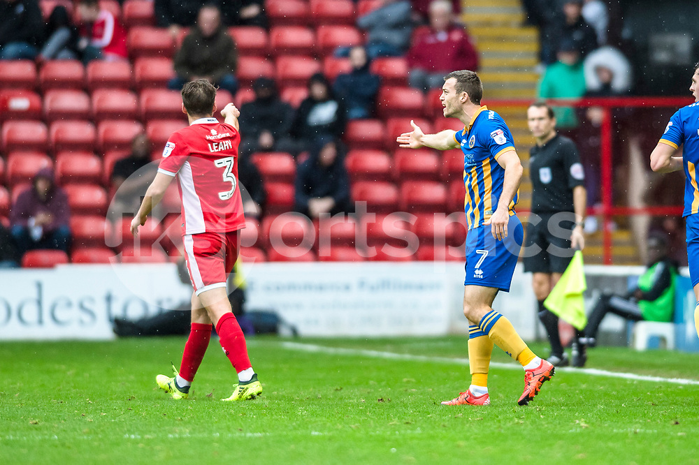 Luke Leahy of Walsall and Shaun Whalley of Shrewsbury Town continue their protests after clashing during the EFL Sky Bet League 1 match between Walsall and Shrewsbury Town at the Banks's Stadium, Walsall, England on 7 October 2017. Photo by Darren Musgrove.