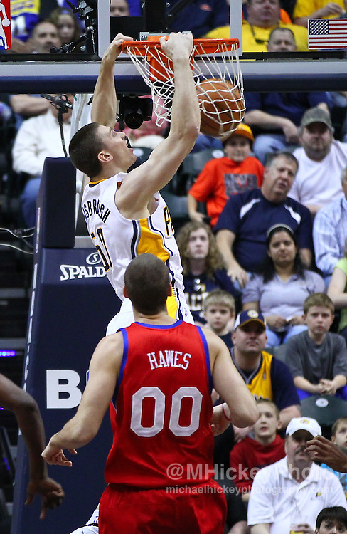 March 14, 2012; Indianapolis, IN, USA; Indiana Pacers power forward Tyler Hansbrough (50) dunks the ball against the Philadelphia 76ers at Bankers Life Fieldhouse. Indiana defeated Philadelphia 111-94. Mandatory credit: Michael Hickey-US PRESSWIRE