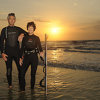May 1, 2010 -- Cocoa Beach, FL, U.S.A..Dr Michelle Henderson and John Ritter pose on the beach with a Kite board...John saved Michelle's life when her kiteboard strings got tangled up. ..CREDIT: Preston Mack .