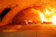 Matza bread baking in a traditional brick oven for Passover, the oven is situated in a small room out the back of Bethune Road synagogue. The baking process from start to finish has to be completed within 18 minutes for it to be Kosher